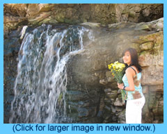 Mina at waterfall with flowers